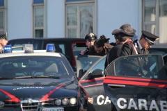 Gli arrestati escono dalla caserma dei carabinieri di Viterbo