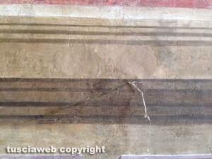 Il nastro adesivo sull'affresco a Palazzo dei priori