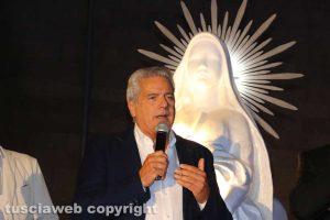 Giovanni Arena e con la statua di santa Rosa