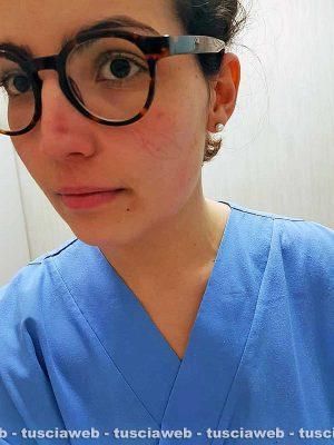 Alessia Ferri - Sul volto dell'infermiera i segni delle protezione da Coronavirus